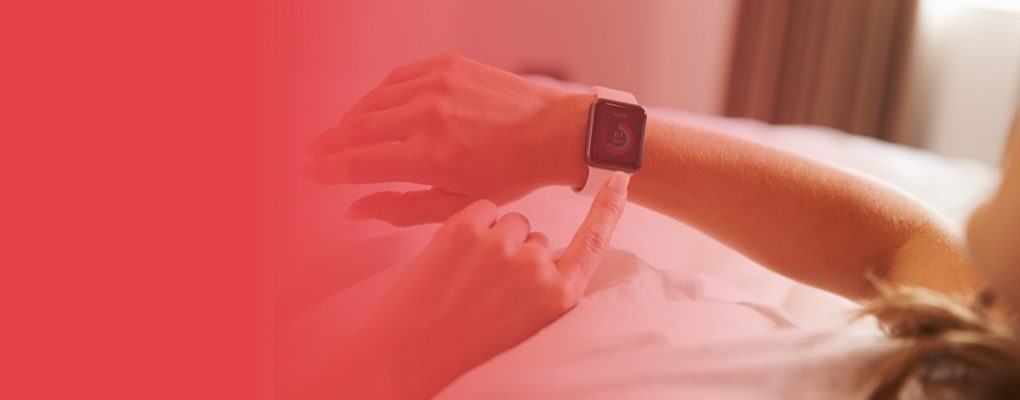 Person pointing to a smart watch