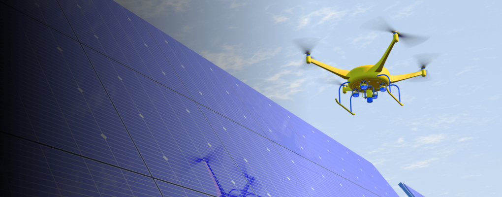 Drone floating above solar panels