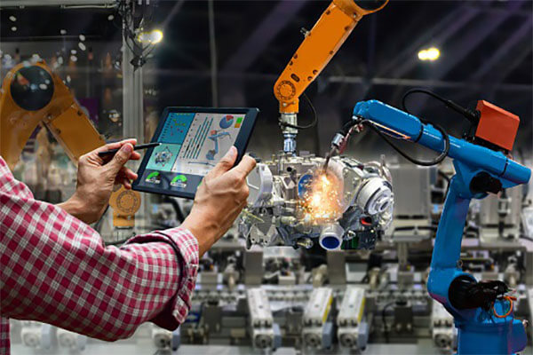 Engineer touch screen control robot the production of factory parts engine manufacturing industry robots and mechanical arm